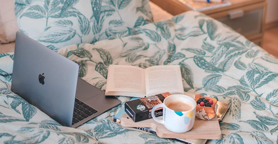 Laptop and coffee in bed